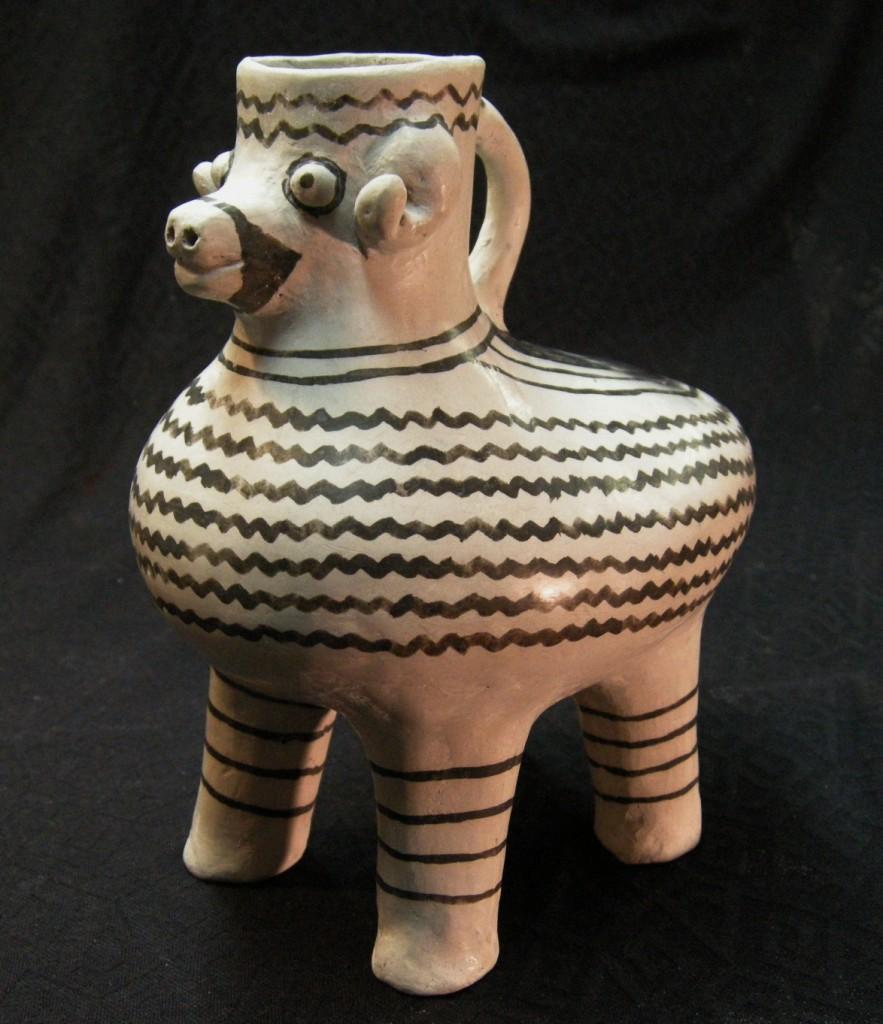 #1790 Cortez B/w mountain sheep effigy pitcher; 21 cm H X 18 cm long X 13 cm wide; $1,200.